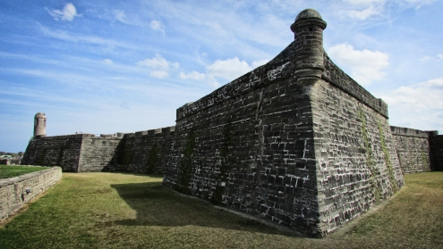 Castillo de San Marcos's walls are composed of 400,000 hand-cut blocks of coquina, a porous, sedimentary stone that compresses upon impact, giving the fort a remarkable resilience to cannon fire. This coquina was once covered by a neat layer of red and white plaster.