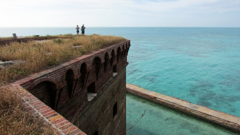 Visitors to the Dry Tortugas arrive by ferry, seaplane, or private vessel. Two of these sightseers stand atop the northwest bastion of Fort Jefferson (1846), fifty feet above the Gulf of Mexico on the fort's open upper level, known as the barbette tier.