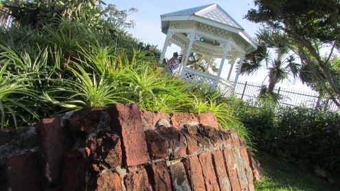 A modern gazebo stands amidst the meticulously manicured ruins of the West Martello Tower, home of the Key West Garden Club since 1955. It is the clearest manifestation of the fort's transformation from implement of war into a monument for peace and harmony.